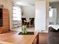 Wohnzimmer und Küche - Ferienwohnung Ihno